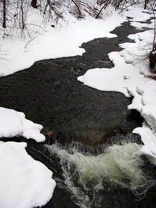 Deer Creek on St. Lawrence Str. W. bridge  by Helen Lessard