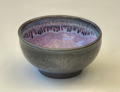 Bowl fired to cone 10 - slip glaze out & copper red in