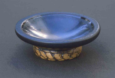 sauce dish w/ manganese glaze & extruded foot