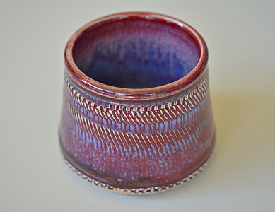 porcelain cup with texture - copper blue under copper red - cone 10 reduction