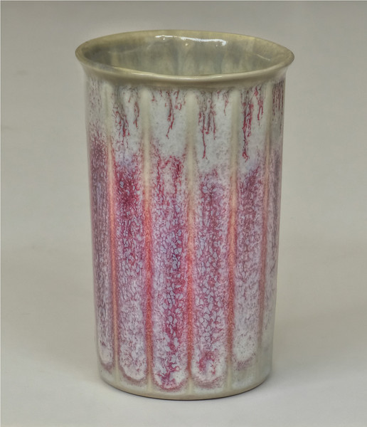 cast porcelain fluted cup w copper reduction glaze