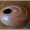 Red terracotta clay (earthenware), finished with bees wax. Hand-built using coils (approx length 19cm). Having achieved the desired overall shape, I carved out and shaped the 'terraces'. Instead of glazing the pot, I finished it off by waxing it. (Autumn 2010)