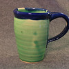 Celedon green with Royal Blue rim and handle.  This is about a 18oz mug, perfect size.