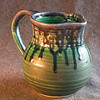 A pitcher by Josh, including original glazes.
