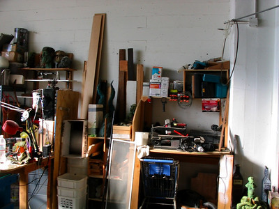 Woodworking tools and scrap wood.  We have several drills, a mitre saw, scroll saw, sanders, rotary saws, and a grinder.