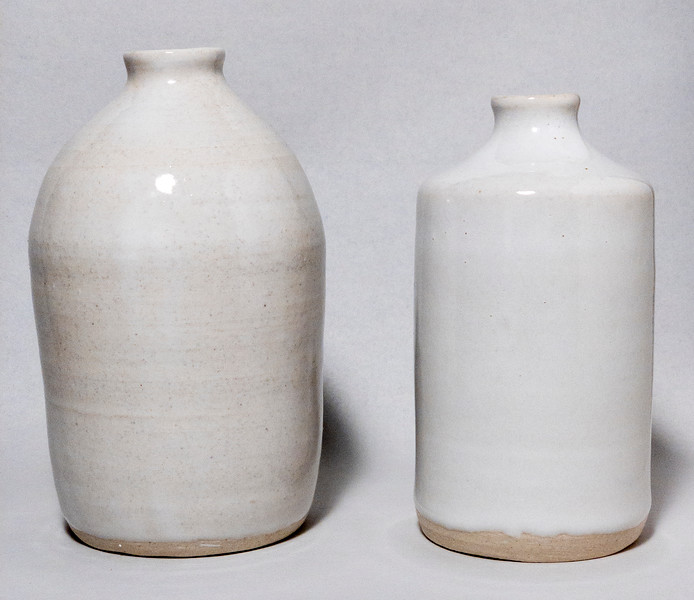 Two white bottles (20DE13, 20DE09)