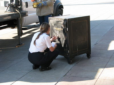 Amtrak rep Rebecca Mercer attempts to open the safe. The combination that she has doesn't seem to work.