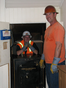 The safe-moving crew included Russell Allen and Louis McBurnie.