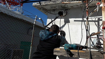 Ricardo prepares solar panel mounting. Cables to other vault to be removed.