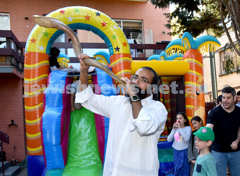 Shofar Factory at Chabad Rose Bay. Rabbi Alon Hazi blows a giant Shofar. Pic Noel Kessel