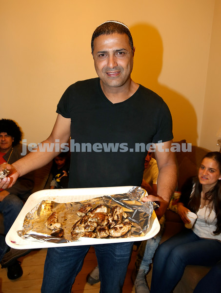 Chabad for Israeli Tourists, Purim Party. Doron Koresh with a tray of BBQ chicken. Pic Noel Kessel