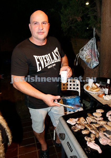 Chabad for Israeli Tourists, Purim Party. Lior Ozana at the BBQ. Pic Noel Kessel.
