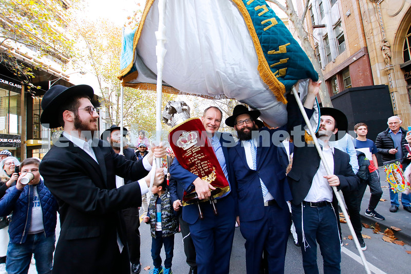 27-5-18. A new Torah for Chabad CBD, Melbourne. The parade with the new Torah making it's way down Collins St. David Southwick, Rabbi Chaim Herzog. Photo: Peter Haskin