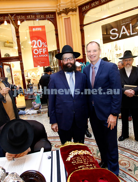 27-5-18. A new Torah for Chabad CBD, Melbourne. Final letters being filled in at the city's iconic Block Arcade. Sofer Shmuel Kesselman. Rabbi Chaim Herzog, David Southwick. Photo: Peter Haskin
