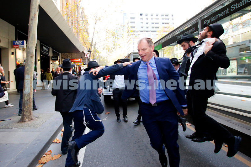 27-5-18. A new Torah for Chabad CBD, Melbourne. The parade with the new Torah making it's way down Collins St. Photo: Peter Haskin
