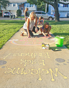 """[in front] Mariah Doyle and her daughter Lena, from boro. Nellie Bennett Eleementary School's """"Chalk the Walk"""" event in Point Pleasant Boro, NJ on 9/3/19. [DANIELLA HEMINGHAUS]"""