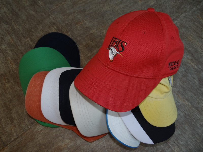 Just a Few of His Golf Hats