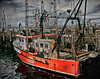 old abandoned red and white fishing boat