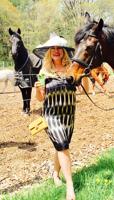 . Me and the boys. Loving these two beauties, Colby and Tax. A special thank-you to my dear Chelmsford High school friend Kathy McDermott, owner of Flying Change Stables of Chelmsford, celebrating 30 years at the farm! I�m wearing a dramatic, oversized black hat with an abundance of cream roses, my silk cocktail dress, black and cream, a pair of Guess patent-leather beige-and-black open-toe pumps! I�m also sipping my Mint Julep and caring a tan Chanel evening bag! All the lovely ladies and gents were dressed for Derby Day! See you next year at the races!