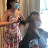 Vanessa Lavin styles the hair of Eleni Delaporta, a registered nurse.