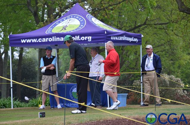 Groups wait to play from first tee, chat with CGA volunteer