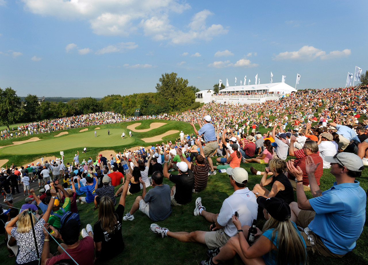 LEMONT, IL - SEPTEMBER 12: Tiger Woods makes hits putt at the 14th green during the third round of the BMW Championship held at Cog Hill Golf & Country Club on September 12, 2009 in Lemont, Illinois. (Photo by Stan Badz/PGA TOUR) *** Local Caption *** Tiger Woods