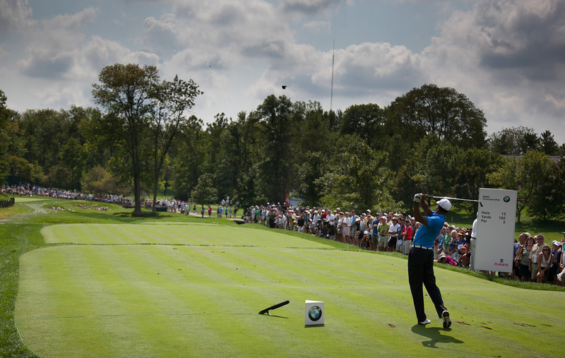 Tiger Woods hits his tee ball on the 13th hole during first round action at the BMW Championship at Crooked Stick CC in Carmel Indiana on Thursday Sept. 6, 2012. (Charles Cherney/WGA)