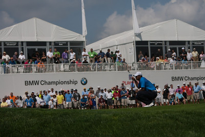 Tiger Woods lines up his putt on the 12th green during first round action at the BMW Championship at Crooked Stick CC in Carmel Indiana on Thursday Sept. 6, 2012. (Charles Cherney/WGA)