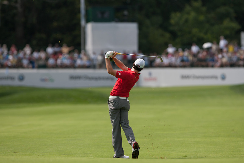 Rory Mcllroy hits his approach shot to the 14th green during first round action at the BMW Championship at Crooked Stick CC in Carmel Indiana on Thursday Sept. 6, 2012. (Charles Cherney/WGA)