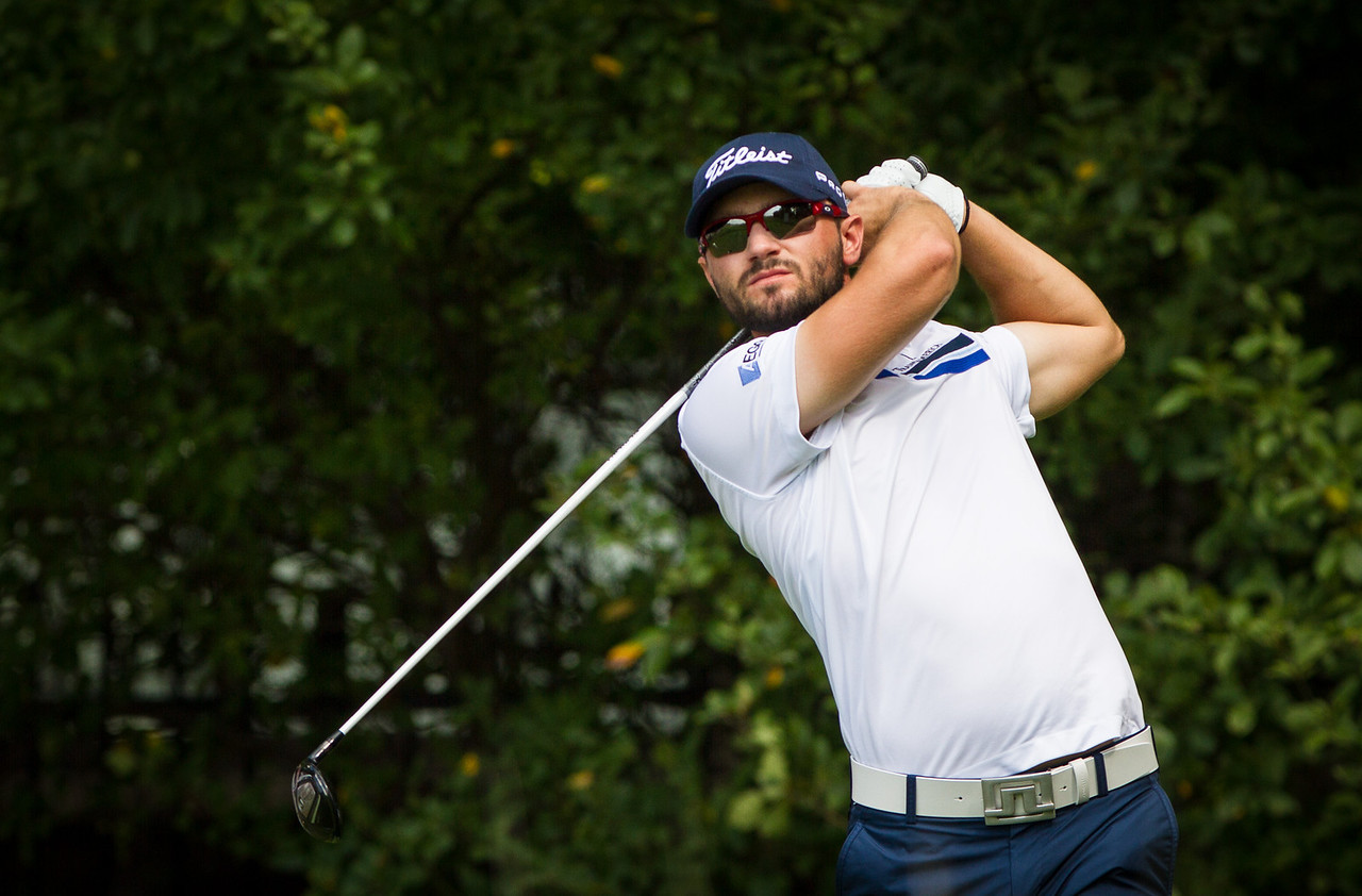 Kyle Stanley hits his tee ball on 12 during first round action at the BMW Championship at Crooked Stick CC in Carmel Indiana on Thursday Sept. 6, 2012. (Charles Cherney/WGA)