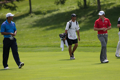 Rory Mcllroy and Tiger Woods chat while walking on the 14th fairway during first round action at the BMW Championship at Crooked Stick CC in Carmel Indiana on Thursday Sept. 6, 2012. (Charles Cherney/WGA)