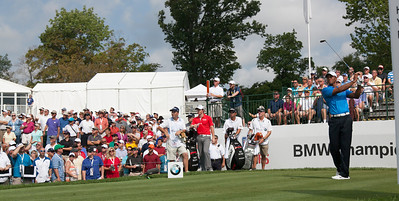 Tiger Woods hits his first shot of the day off the 10th tee during first round action at the BMW Championship at Crooked Stick CC in Carmel Indiana on Thursday Sept. 6, 2012. (Charles Cherney/WGA)