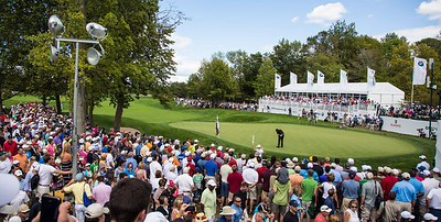 Crowd watches Phil Mickelson make a birdie putt on the 9th hole during the final round of the 2012 BMW Championship at Crooked Stick Golf Course in Carmel Indiana on Sunday Sept. 9, 2012 (Charles Cherney/WGA)
