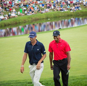 Dustin Johnson and Tiger Woods walk to the 17th tee during the final round of the 2012 BMW Championship at Crooked Stick Golf Course in Carmel Indiana on Sunday Sept. 9, 2012 (Charles Cherney/WGA)
