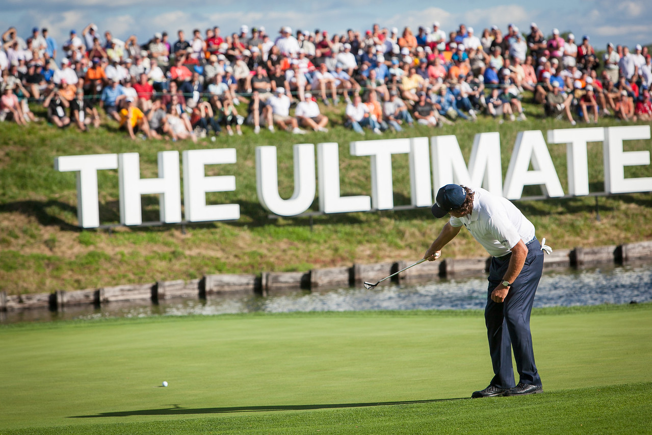 Phil Mickelson putts for birdie at the 18th hole which he made and is currently tied for the lead during third round play at the BMW Championship in Carmel Indiana on Saturday Sept. 8, 2012. (Charles Cherney/WGA)