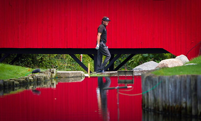 Phil  Mickelson crosses in front of a covered bridge after hitting his tee shot on the 7th hole during the final day of the 2012 BMW Championship at Crooked Stick Golf Course in Carmel Indiana on Sunday Sept. 9, 2012 (Charles Cherney/WGA)