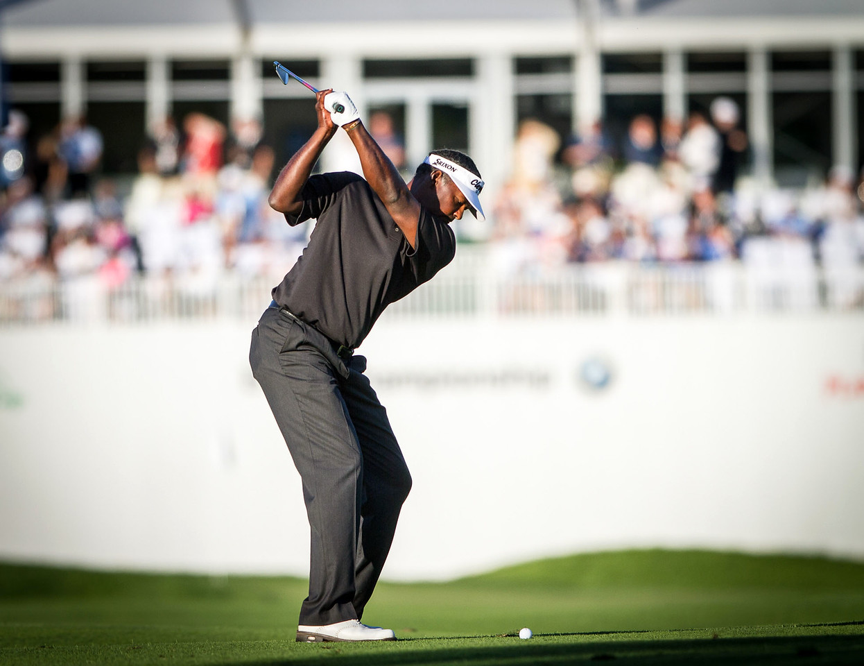 Vijay Singh about to hit his approach shot to 18. Singh is currently tied for the lead at the BMW Championship in Carmel Indiana on Saturday Sept. 8, 2012. (Charles Cherney/WGA)
