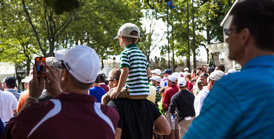 A young fan watches the action at the 9th green during the final day of the BMW Championship at the Crooked Stick Golf Course in Carmel Indiana on Sunday Sept. 9, 2012 (Charles Cherney/WGA)
