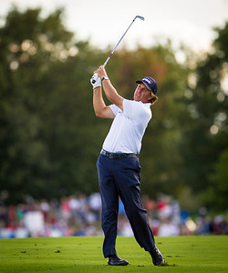 Phil Mickelson hits his approach shotl on 18 at the BMW Championship in Carmel Indiana on Saturday Sept. 8, 2012. (Charles Cherney/WGA)