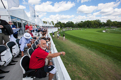 Fans watch the golf action from a skybox along the 14th hole during third round play at the BMW Championship in Carmel Indiana on Saturday Sept. 8, 2012. (Charles Cherney/WGA)