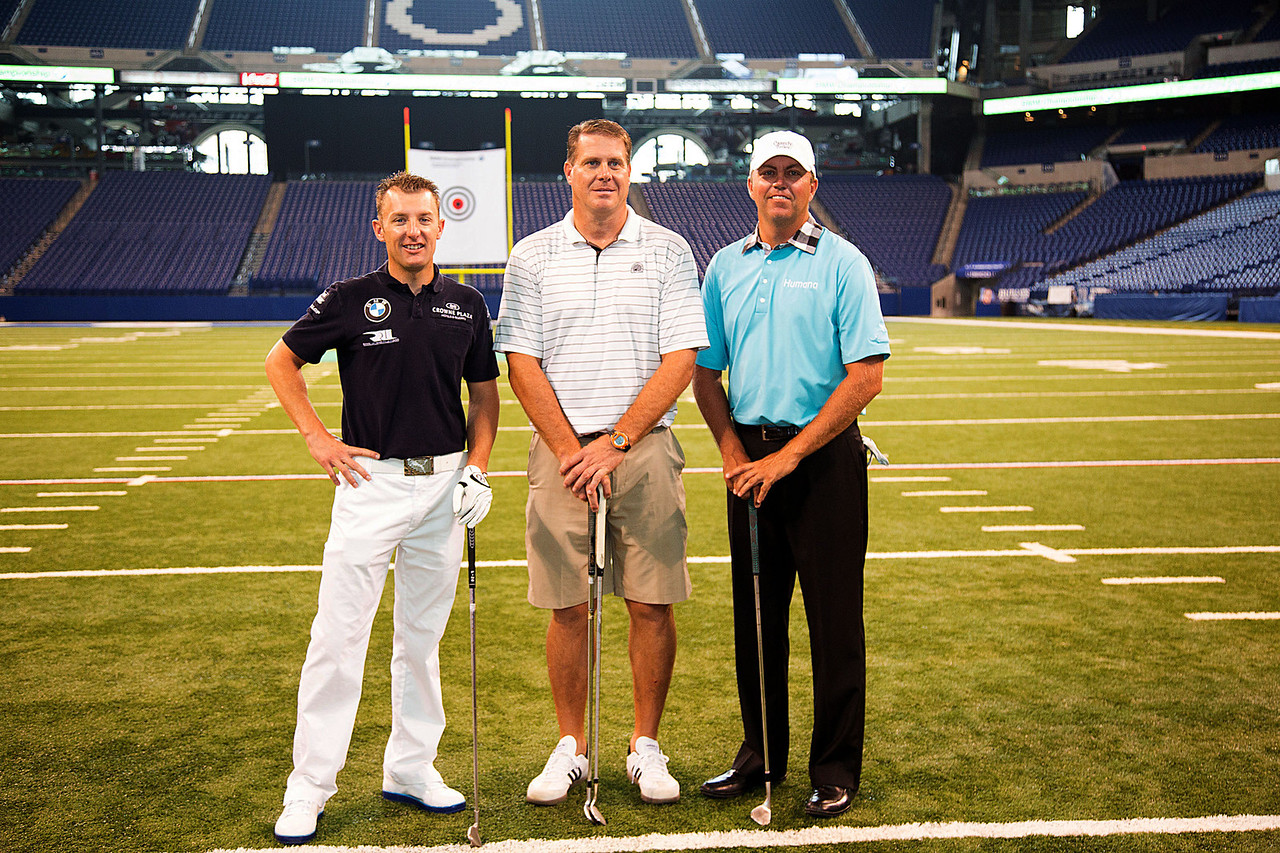 BMW ALMS Champion Driver Joey Hand, former Colts TE Ken Dilger and PGA TOUR Pro Bo Van Pelt kicked-off the 2012 BMW Championship by attempting to hit a golf ball though a 12-inch hole in a 19-foot by 22-foot target hung between the uprights inside the Colts' Lucas Oil Stadium in Indianapolis Tuesday, September 4, 2012. The group was on hand to raise money for the Evans Scholars Foundation, the nation's largest privately funded college tuition and housing scholarship program. All proceeds of the BMW Championship, the third leg in the PGA TOUR playoffs for the FedExCup, benefit the Evans Scholars (WGA Photo/Charles Cherney).
