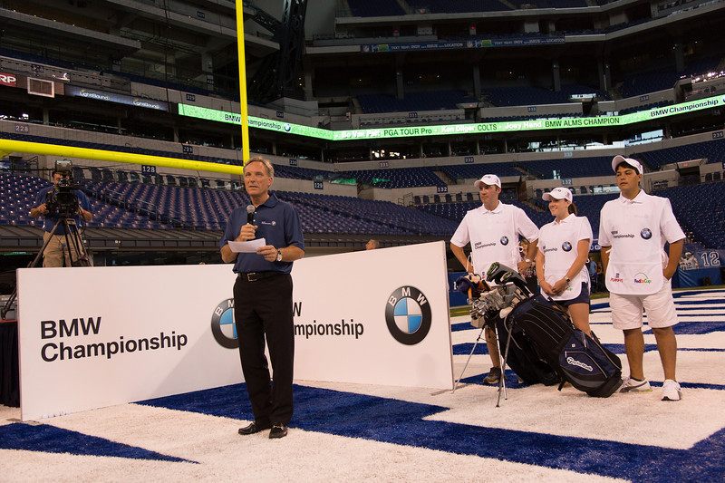 Tom Plucinsky, manager, BMW corporate communications, starts the ceremony to kick-off the 2012 BMW Championship at the Colts' Lucas Oil Stadium in Indianapolis Tuesday, September 4, 2012. PGA TOUR Pro Bo Van Pelt, Former Colts TE Ken Dilger and BMW ALMS Champion Driver Joey hand to raise money for the Evans Scholars Foundation, the nation's largest privately funded college tuition and housing scholarship program. All proceeds of the BMW Championship, the third leg in the PGA TOUR playoffs for the FedExCup, benefit the Evans Scholars (WGA Photo/Charles Cherney).