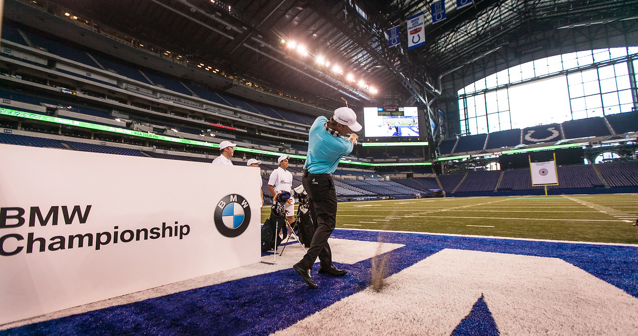PGA TOUR Pro Bo Van Pelt kicks-off the 2012 BMW Championship by attempting to hit a golf ball though a 12-inch hole in a 19-foot by 22-foot target hung between the uprights inside the Colts' Lucas Oil Stadium in Indianapolis Tuesday, September 4, 2012. Van Pelt and other athletes were on hand to raise money for the Evans Scholars Foundation, the nation's largest privately funded college tuition and housing scholarship program. All proceeds of the BMW Championship, the third leg in the PGA TOUR playoffs for the FedExCup, benefit the Evans Scholars (WGA Photo/Charles Cherney).