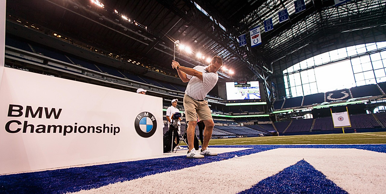 Former Indianapolis Colts TE Ken Dilger kicks-off the 2012 BMW Championship by attempting to hit a golf ball though a 12-inch hole in a 19-foot by 22-foot target hung between the uprights inside the Colts' Lucas Oil Stadium in Indianapolis Tuesday, September 4, 2012. Dilger and other athletes were on hand to raise money for the Evans Scholars Foundation, the nation's largest privately funded college tuition and housing scholarship program. All proceeds of the BMW Championship, the third leg in the PGA TOUR playoffs for the FedExCup, benefit the Evans Scholars (WGA Photo/Charles Cherney).