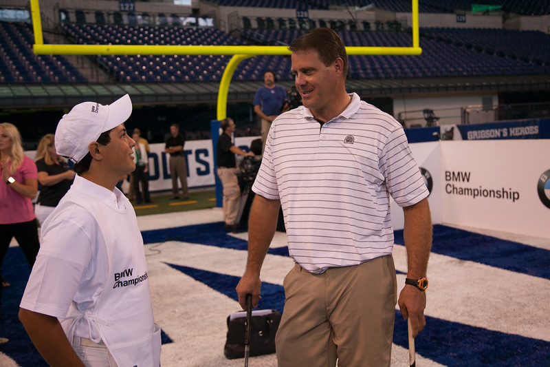 Former Colts TE Ken Dilger speaks with Evans Scholar Justin Cruz at the Colts' Lucas Oil Stadium in Indianapolis Tuesday, September 4, 2012. Dilger, PGA TOUR Pro Bo Van Pelt and BMW ALMS Champion Driver Joey Hand were on hand to raise money for the Evans Scholars Foundation, the nation's largest privately funded college tuition and housing scholarship program. All proceeds of the BMW Championship, the third leg in the PGA TOUR playoffs for the FedExCup, benefit the Evans Scholars (WGA Photo/Charles Cherney).