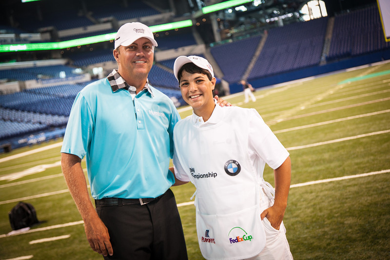 PGA TOUR Pro Bo Van Pelt stands with Evans Scholar Justin Cruz at the Colts' Lucas Oil Stadium in Indianapolis Tuesday, September 4, 2012. Van Pelt and other athletes were on hand to raise money for the Evans Scholars Foundation, the nation's largest privately funded college tuition and housing scholarship program. All proceeds of the BMW Championship, the third leg in the PGA TOUR playoffs for the FedExCup, benefit the Evans Scholars (WGA Photo/Charles Cherney).