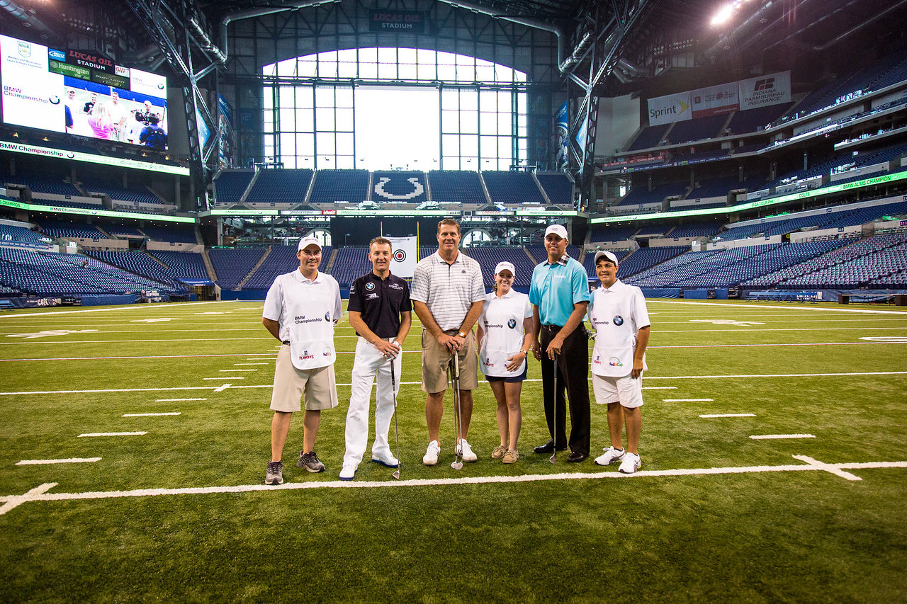 BMW ALMS Champion Driver Joey Hand, former Colts TE Ken Dilger and PGA TOUR Pro Bo Van Pelt with Evans Scholars Eddie Arauco, Erin Indovina and Justin Cruz at the Colts' Lucas Oil Stadium in Indianapolis Tuesday, September 4, 2012. The group was on hand to raise money for the Evans Scholars Foundation, the nation's largest privately funded college tuition and housing scholarship program. All proceeds of the BMW Championship, the third leg in the PGA TOUR playoffs for the FedExCup, benefit the Evans Scholars (WGA Photo/Charles Cherney).