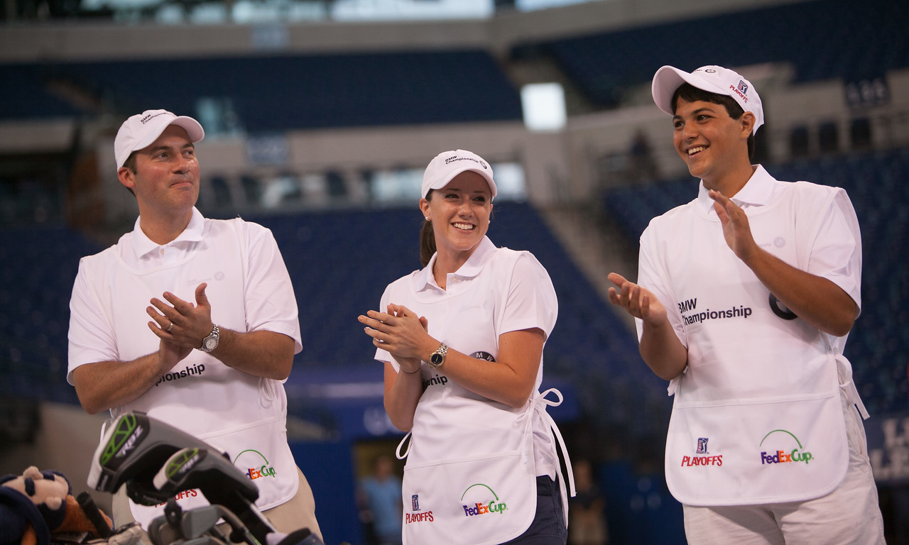 Evans Scholars Eddie Arauco, Erin Indovina and Justin Cruz, at the kick-off event for the 2012 BMW Championship at the Colts' Lucas Oil Stadium in Indianapolis Tuesday, September 4, 2012. PGA TOUR Pro Bo Van Pelt and other athletes were on hand to raise money for the Evans Scholars Foundation, the nation's largest privately funded college tuition and housing scholarship program. All proceeds of the BMW Championship, the third leg in the PGA TOUR playoffs for the FedExCup, benefit the Evans Scholars (WGA Photo/Charles Cherney).