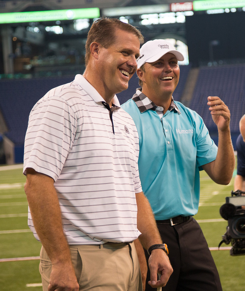 Former Indianapolis Colts TE Ken Dilger and PGA TOUR Pro Bo Van Pelt at an event to kick-off the 2012 BMW Championship at Lucas Oil Stadium in Indianapolis Tuesday, September 4, 2012. The duo were joined by BMW ALMS Champion Driver Joey Hand who were on hand to raise money for the Evans Scholars Foundation, the nation's largest privately funded college tuition and housing scholarship program. All proceeds of the BMW Championship, the third leg in the PGA TOUR playoffs for the FedExCup, benefit the Evans Scholars (WGA Photo/Charles Cherney).