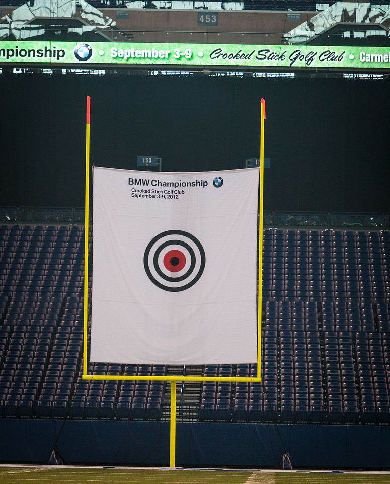 PGA TOUR Pro Bo Van Pelt, former Indianapolis Colts TE Ken Dilger and BMW ALMS Champion Driver Joey Hand kicked-off the 2012 BMW Championship by attempting to hit a golf ball though a 12-inch hole in a 19-foot by 22-foot target hung between the uprights inside the Colts' Lucas Oil Stadium in Indianapolis Tuesday, September 4, 2012. The group was on hand to raise money for the Evans Scholars Foundation, the nation's largest privately funded college tuition and housing scholarship program. All proceeds of the BMW Championship, the third leg in the PGA TOUR playoffs for the FedExCup, benefit the Evans Scholars (WGA Photo/Charles Cherney).